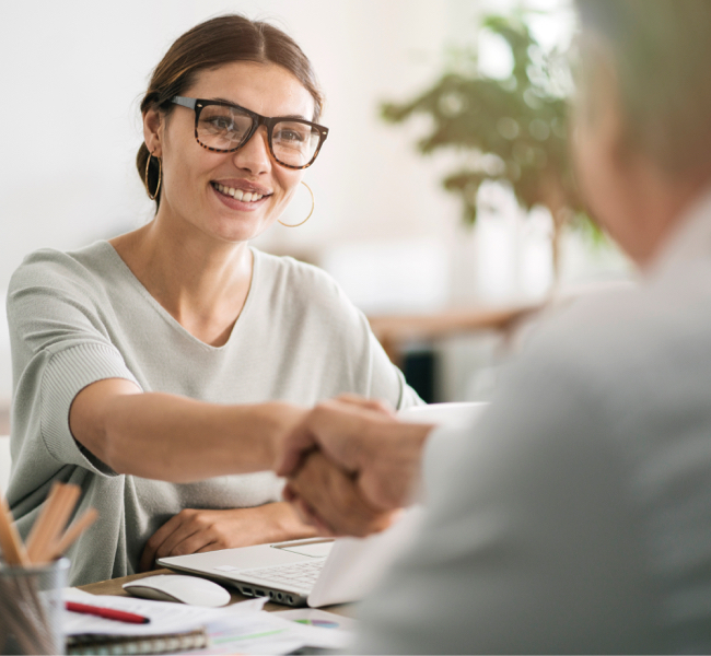 Woman shaking hands across table