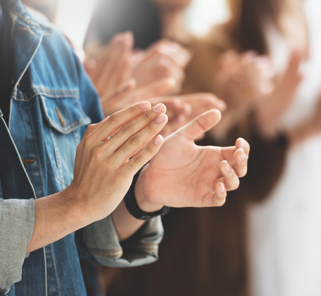 Close up of hands clapping